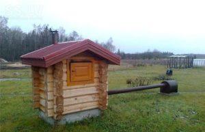 Деревянный коптильный шкаф из бревен