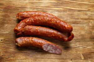 Сырокопченая колбаса горячего копчения